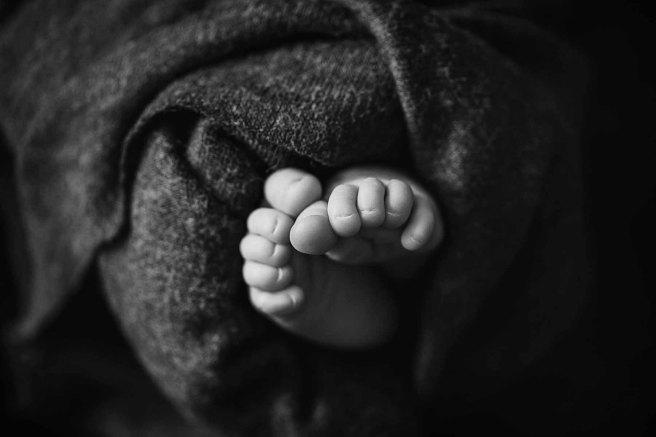 Macro shot of Newborn baby toes