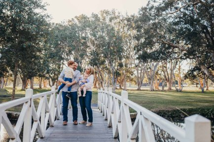 A family Photography session on a bridge in a Sydney park