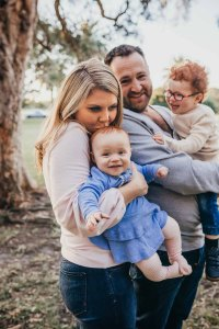 A family cuddle at sunset during their Sydney Family Photo shoot