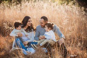 A family share a giggle during a family photo session