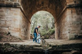 A family explores the historic arch of Lennox Bridge in Glenbrook